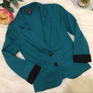 Colorful teal blazer with black contrasting detail